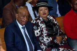 Lesotho's Prime Minister, Thomas Thabane, left, and his wife Maesaiah, right are seated in court, in Maseru, Monday, Feb. 24,…