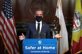 This still image taken from a live stream provided by Office of Mayor Eric Garcetti shows Los Angeles Mayor Garcetti displaying…