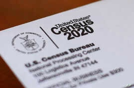 This Sunday, April 5, 2020, photo shows an envelope containing a 2020 census letter mailed to a U.S. resident in Detroit. If…