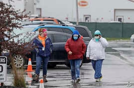 Tyson Fresh Meats plant employees arrive at the plant, Thursday, April 23, 2020, in Logansport, Ind. The plant will temporarily…