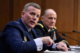 Gen. Tod D. Wolters, commander of U.S. European Command and NATO Supreme Allied Commander Europe, left, and Gen. Stephen Lyons,…