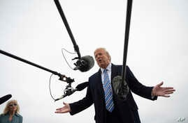 President Donald Trump speaks to the press before boarding Air Force One in Andrews Air Force Base, Md., Saturday, March 28,…