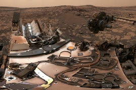 This composite image from Aug. 9, 2018 photos made available by NASA shows the Curiosity rover at Vera Rubin Ridge on Mars. A…