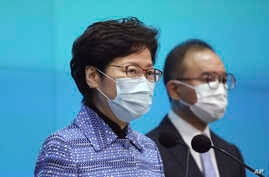 Chief Executive Carrie Lam, left, with Secretary for Constitutional and Mainland Affairs Erick Tsang Kwok-wai, speaks during a…