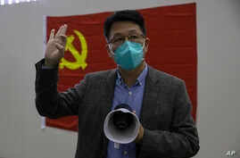 Dr. Zhang Junjian, former head of one of three temporary coronavirus hospitals, speaks to journalist near a Chinese Communist…