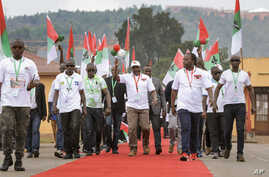 Current president Pierre Nkurunziza, center, arrives at the national conference for the ruling CNDD-FDD party in the rural…