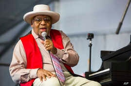 FILE - This April 28, 2019 file photo shows Ellis Marsalis during the New Orleans Jazz & Heritage Festival in New Orleans. The…