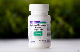 FILE - This Tuesday, April 7, 2020 file photo shows a bottle of hydroxychloroquine tablets in Texas City, Texas. On Friday,…