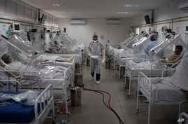 COVID-19 patients are treated inside a non-invasive ventilation system named the 'Vanessa Capsule' at the municipal field…