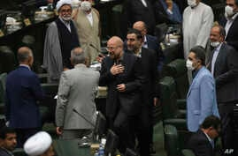 Mohammad Bagher Qalibaf, center, greets lawmakers after being elected as speaker of the parliament, in Tehran, Iran, Thursday,…