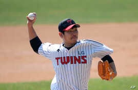 "Letters reading ""Corona 19 Out"" is seen on the cap of LG Twins baseball team's pitcher Jeong Chan-heon as a part of campaign to…"