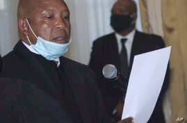 Lesotho's new Prime Minster Moeketsi Majoro is sworn in in Maseru, Lesotho, Wednesday, May 20, 2020. Majoro replaces outgoing…