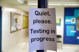 FILE - In this Jan. 17, 2016 file photo, a sign is seen at the entrance to a hall for a college test preparation class in…