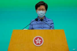 Hong Kong Chief Executive Carrie Lam listens to reporters' questions during a press conference in Hong Kong, Tuesday, May 26,…
