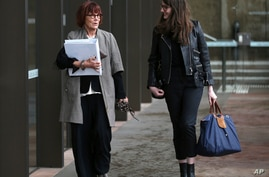 Prof. Jenny Hocking, left, arrives at the Federal Court in Sydney, Monday, July 31, 2017. Hocking, a Monash University…