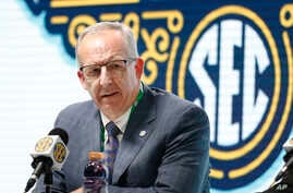 FILE - In this March 11, 2020, file photo, Southeastern Conference Commissioner Greg Sankey speaks in Nashville, Tenn…