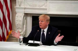 President Donald Trump tells reporters that he is taking zinc and hydroxychloroquine during a meeting with restaurant industry…