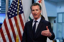 FILE - In this April 14, 2020, file photo, California Gov. Gavin Newsom gestures during a news conference at the Governor's…