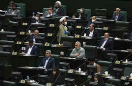 Lawmakers listen to a speech during the inauguration ceremony of Iran's new parliament, in Tehran, Iran, Wednesday, May, 27,…