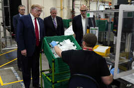 President Donald Trump participates in a tour of a Honeywell International plant that manufactures personal protective…