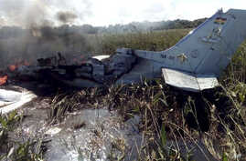The remains of an aircraft from the Bolivian Air Force burn after crashing near Trinidad, Bolivia, Saturday, May 2, 2020. The…