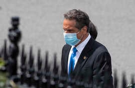 New York Gov. Andrew Cuomo walks towards the West Wing as he arrives at the White House for a meeting with President Donald…