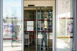 A resident watches nurses leaving the Vilanova nursing home in Corbas, near Lyon, central France, Monday, May 4, 2020. For 47…
