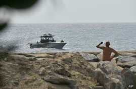 Security forces patrol near the shore in the port city of La Guaira, Venezuela, Sunday, May 3, 2020. Interior Minister Nestor…