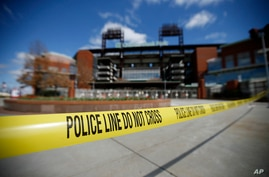 Police tape blocks an entrance to Citizens Bank Park, home of the Philadelphia Phillies baseball team, Tuesday, March 24, 2020,…
