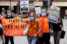 A small group of protesters march in Sydney, Saturday, June 13, 2020, during a day of demonstrations across Australia in…