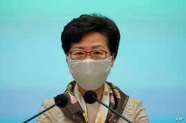 Hong Kong Chief Executive Carrie Lam listens to reporters questions during a press conference in Hong Kong, Tuesday, June 2,…