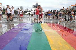 """Participants rally during the """"Taiwan Pride March for the World!"""" at Liberty Square at the CKS Memorial Hall in Taipei, Taiwan,…"""