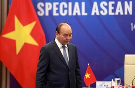 Vietnamese Prime Minister Nguyen Xuan Phuc walks to his desk ahead of the Special ASEAN summit on COVID-19 in Hanoi, Vietnam…