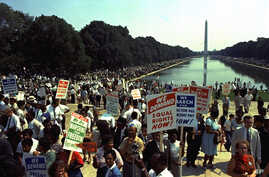 "People carry civil rights signs as they gather in Washington, D.C. before Martin Luther King Jr.'s ""I Have a Dream"" speech on…"