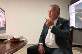 In this April 29, 2020 photo, Venezuelan shipping magnate Wilmer Ruperti smokes a cigarette during an interview in Caracas,…