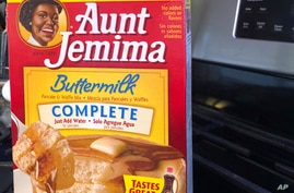 A box of Aunt Jemima pancake mix sits on a stovetop Wednesday, June 17, 2020, in Harrison, N.Y. Pepsico is changing the name…