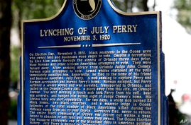 FILE- In this June 21, 2019 file photo, a historical marker was unveiled in Orlando, Fla. July Perry was lynched by a white mob…