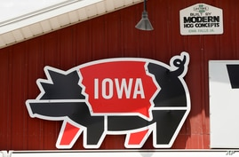 A sign hangs over the pork tent on the Iowa State Fairgrounds, Wednesday, June 10, 2020, in Des Moines, Iowa. This summer's…