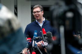 Serbia's President Aleksandar Vucic, addresses the media outside a polling station,  in Belgrade, Serbia, Sunday, June 21, 2020…