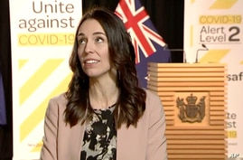In this image made from video, New Zealand Prime Minister Jacinda Ardern looks up when an earthquake struck during a live…