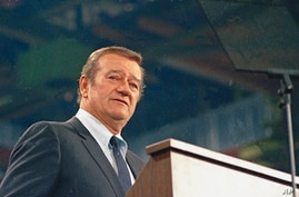 FILE - In this 1968 file photo, actor John Wayne looks on. In the latest move to change place names in light of U.S. racial…