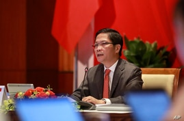 Vietnamese Trade Minister Tran Tuan Anh speaks during an online ASEAN ministerial meeting in Hanoi, Vietnam, Thursday, June 4,…