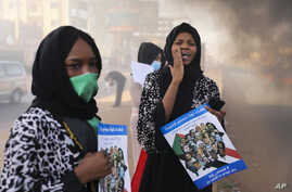 Sudanese women shout during a demonstration to commemorate the first anniversary of a deadly crackdown carried out by security…
