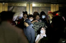 Police officers surround a group of people at Radio City Music Hall before arresting them in New York, Monday, June 1, 2020…