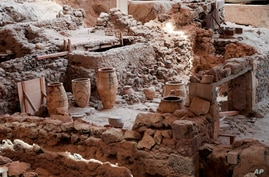 In this handout photo provided by the Greek Prime Minister's Office , ancient jars are seen inside the 16th century BC…