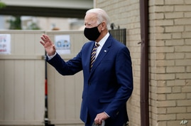 Democratic presidential candidate, former Vice President Joe Biden waves as he arrives to meet with with small business owners,…