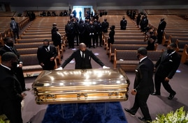 The casket of George Floyd is placed in the chapel during a funeral service for Floyd at the Fountain of Praise church, Tuesday…