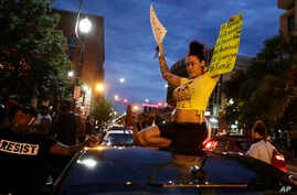 Demonstrators protest over the deaths of George Floyd and Breonna Taylor, Monday, June 1, 2020, in Louisville, Ky. Breonna…