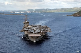 PHILIPPINE SEA (June 4, 2020)In this June 4, 2020, photo provided by the U.S. Navy, the aircraft carrier USS Theodore Roosevelt…