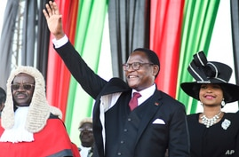 Malawi's newly elected President Lazarus Chakwera greets supporters after being sworn in in Lilongwe, Malawi, Sunday, June 28…